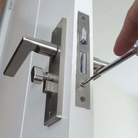 locksmith repair on a door inside a house